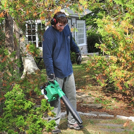 Man Using Hitachi RB24EAP 23.9cc 2-Cycle Gas Powered 170 MPH Handheld Leaf Blower