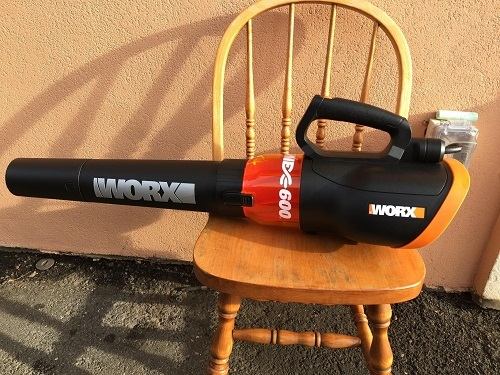 WORX TURBINE 12 Amp Corded Leaf Blower with 110 MPH and 600 CFM Output and Variable Speed Control On Chair
